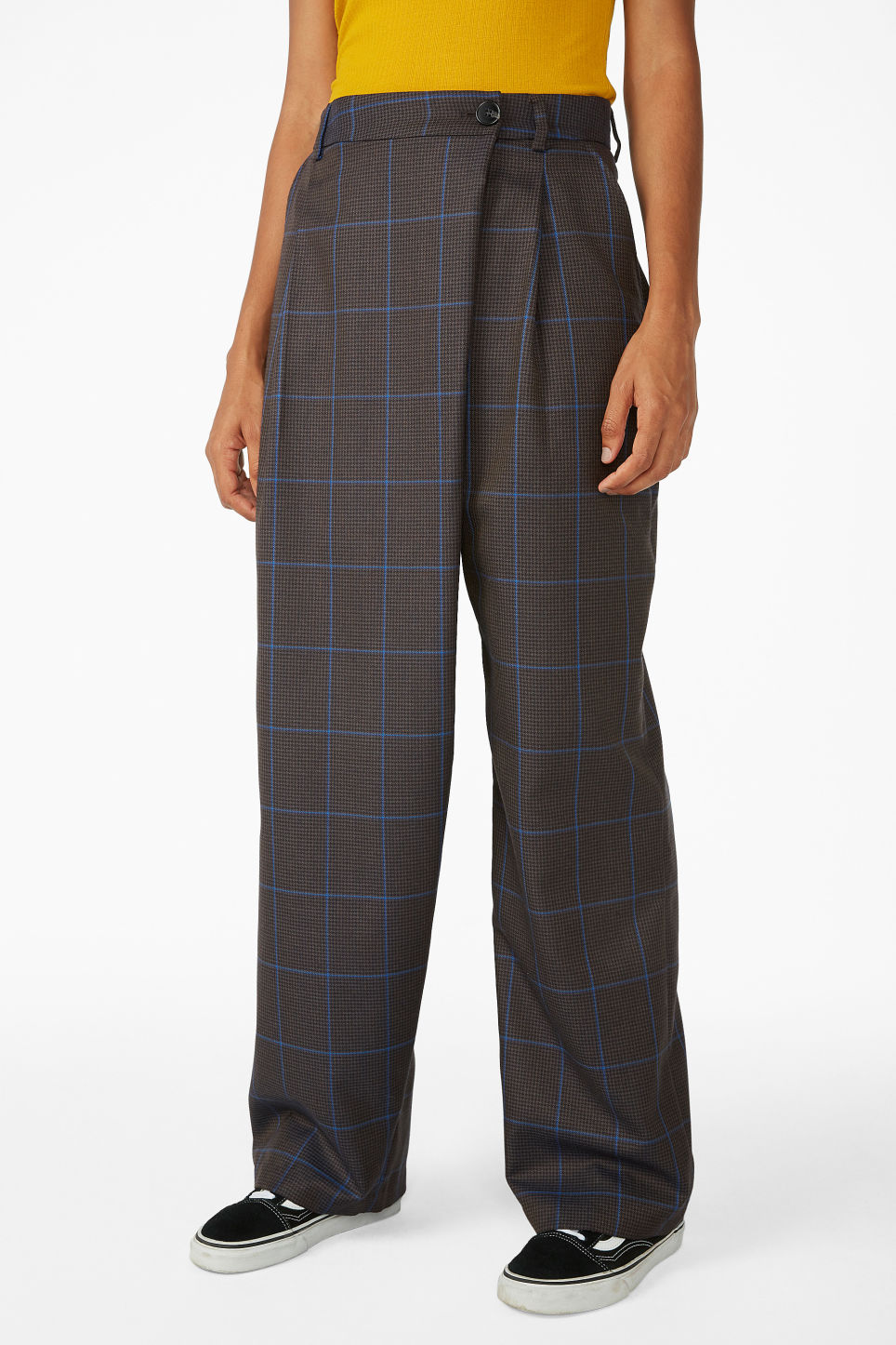 Model side image of Monki checked trousers in grey
