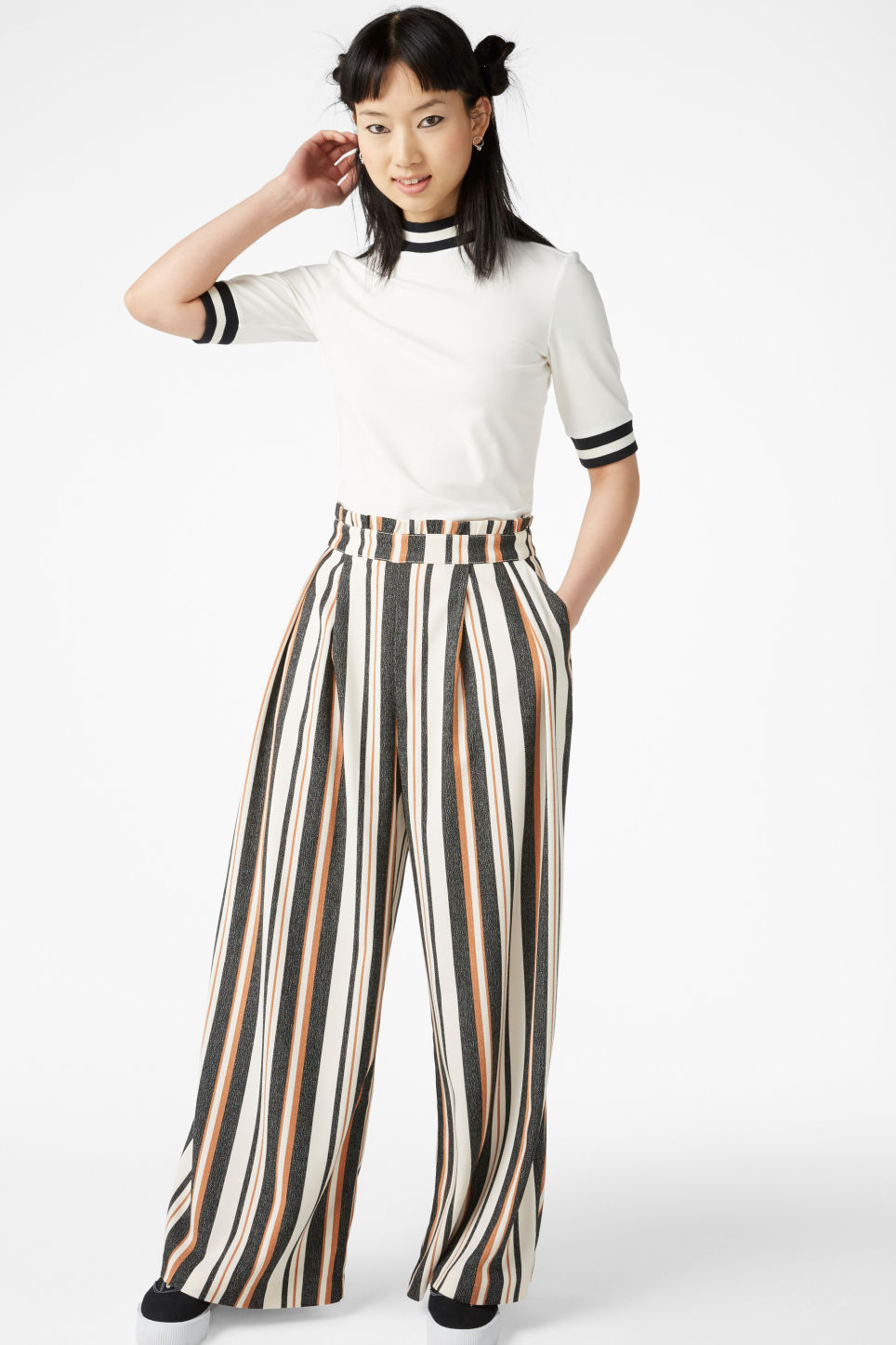 Model side image of Monki turtleneck top in white
