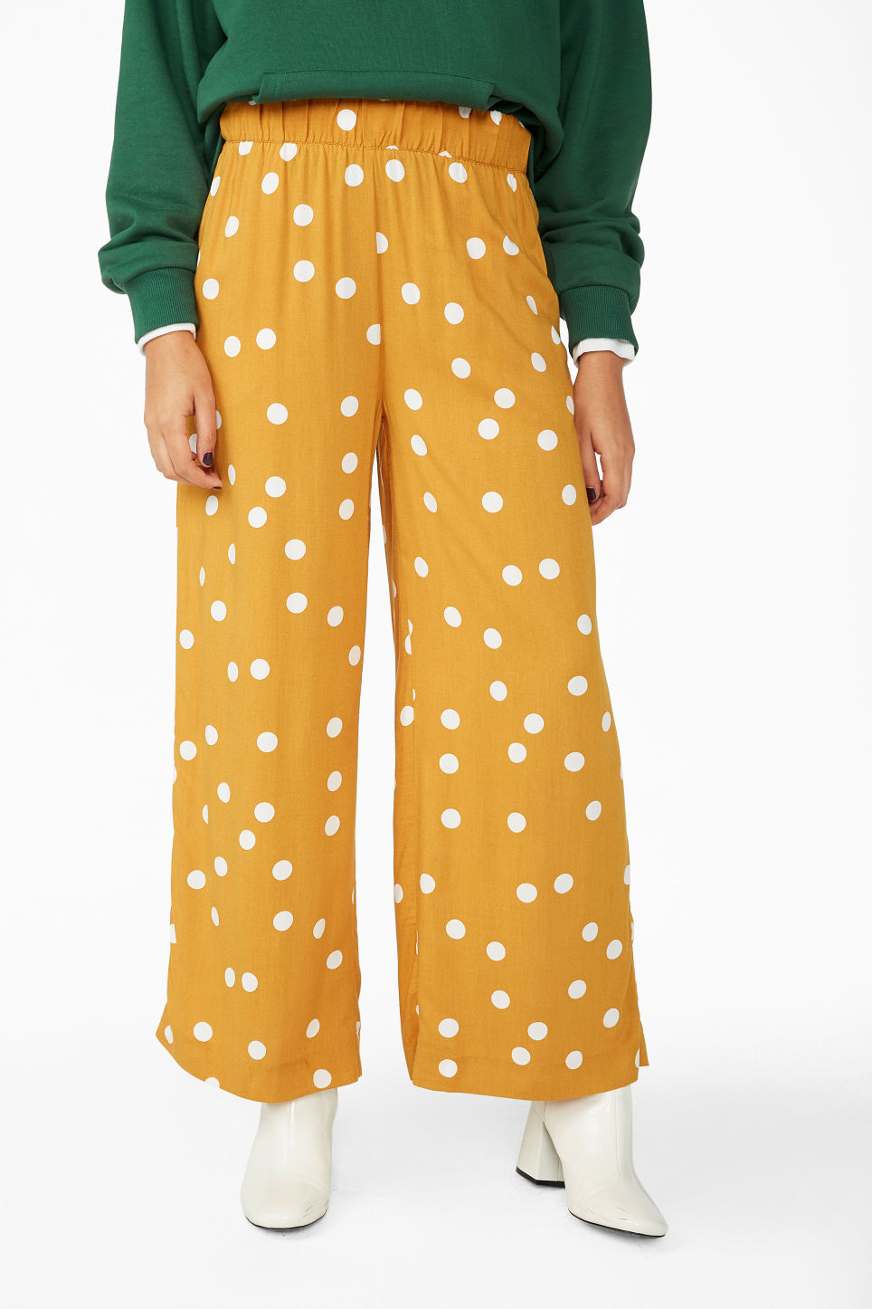 Model side image of Monki flowy trousers in yellow