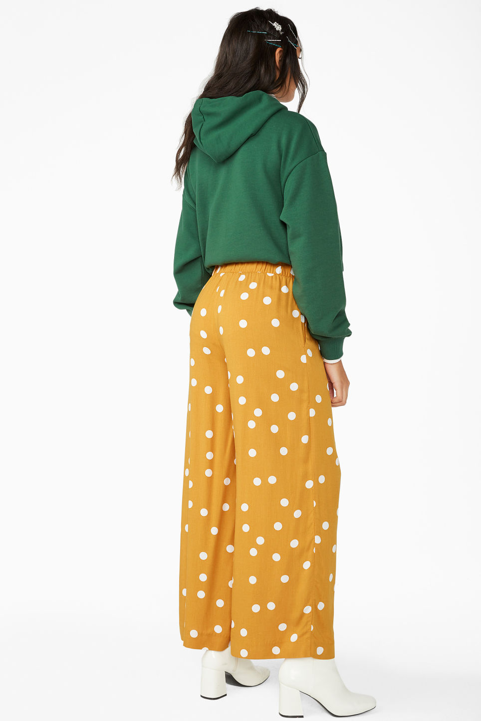Model back image of Monki flowy trousers in yellow