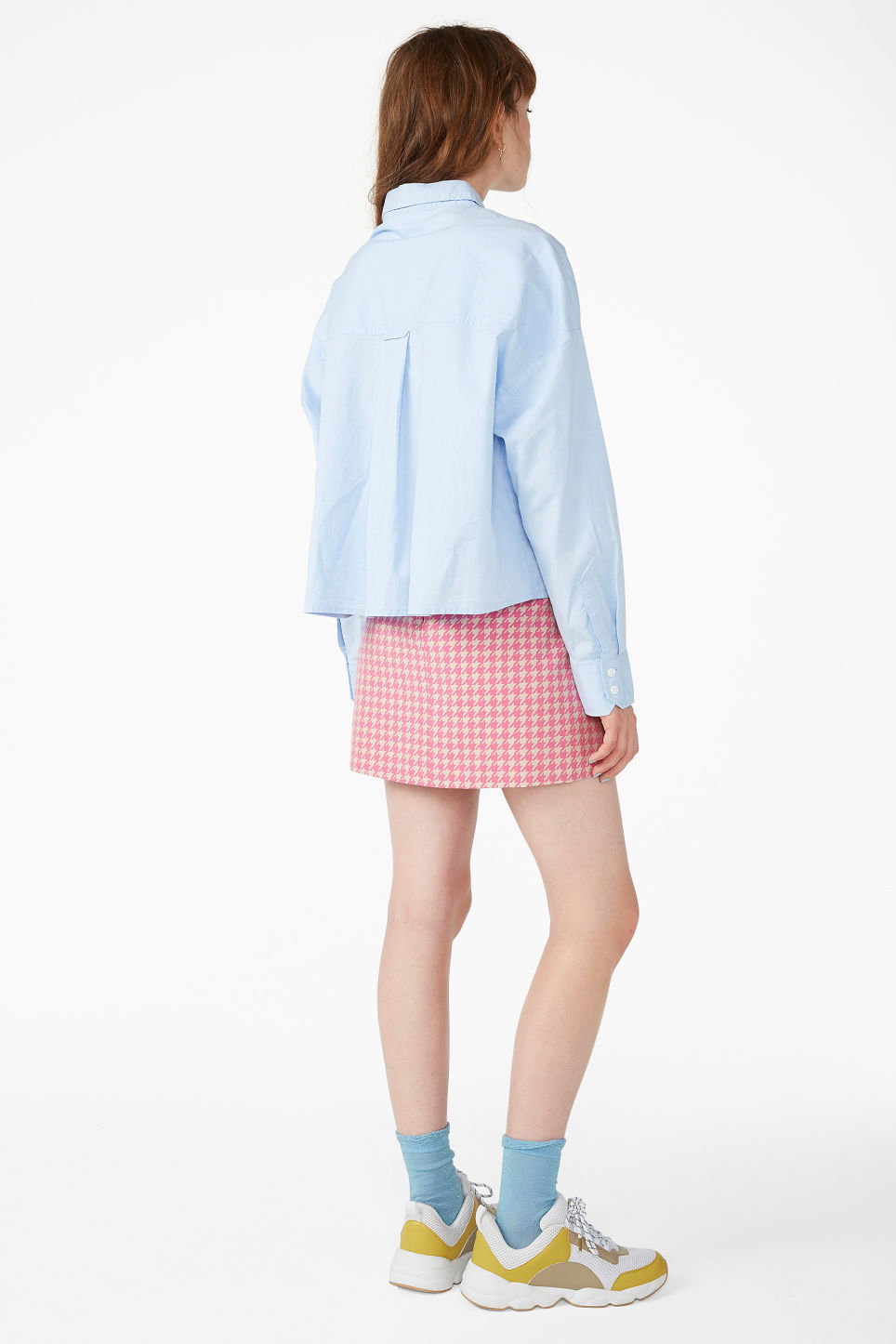 Model back image of Monki button-up shirt in blue
