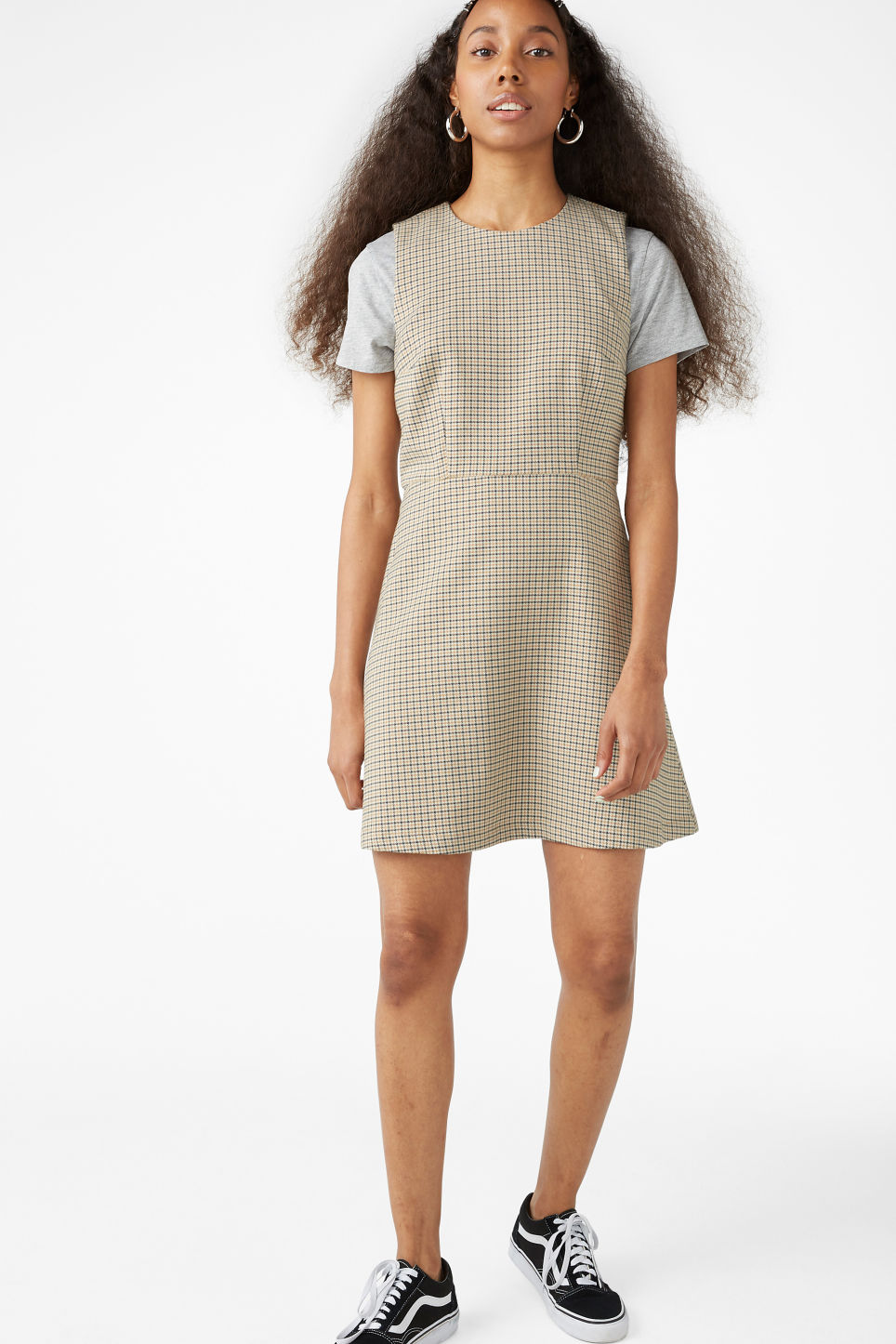 Model side image of Monki sleeveless dress in yellow