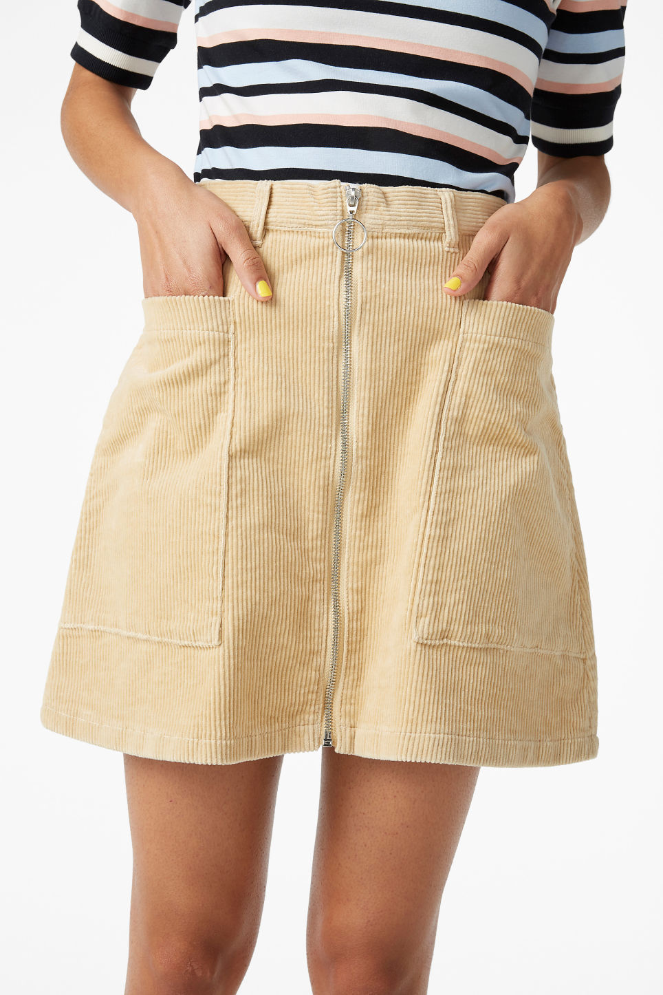 Model side image of Monki mini skirt in beige