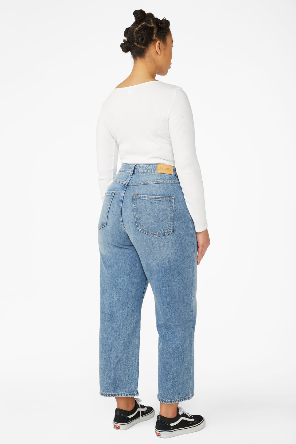 Model side image of Monki mozik mid blue jeans in blue