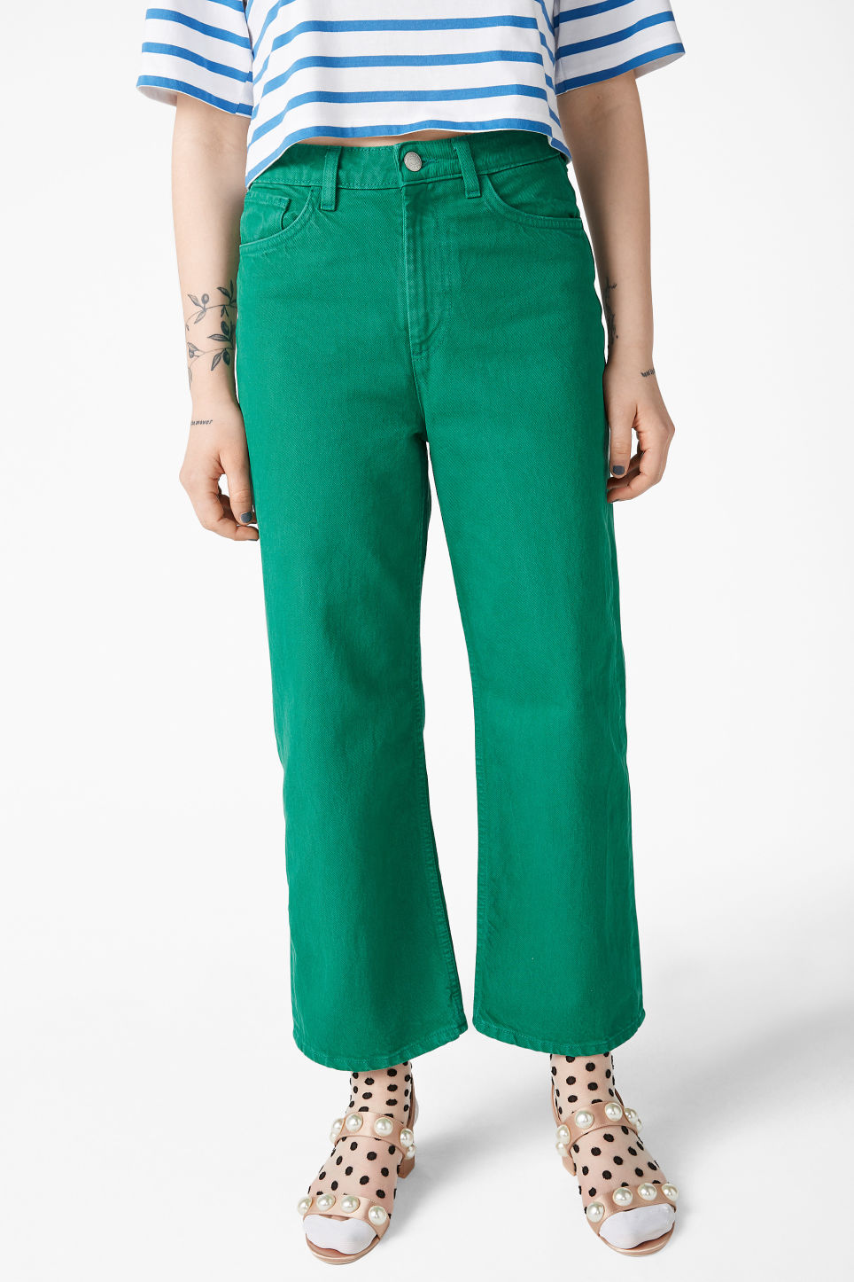 Model side image of Monki mozik jeans in green
