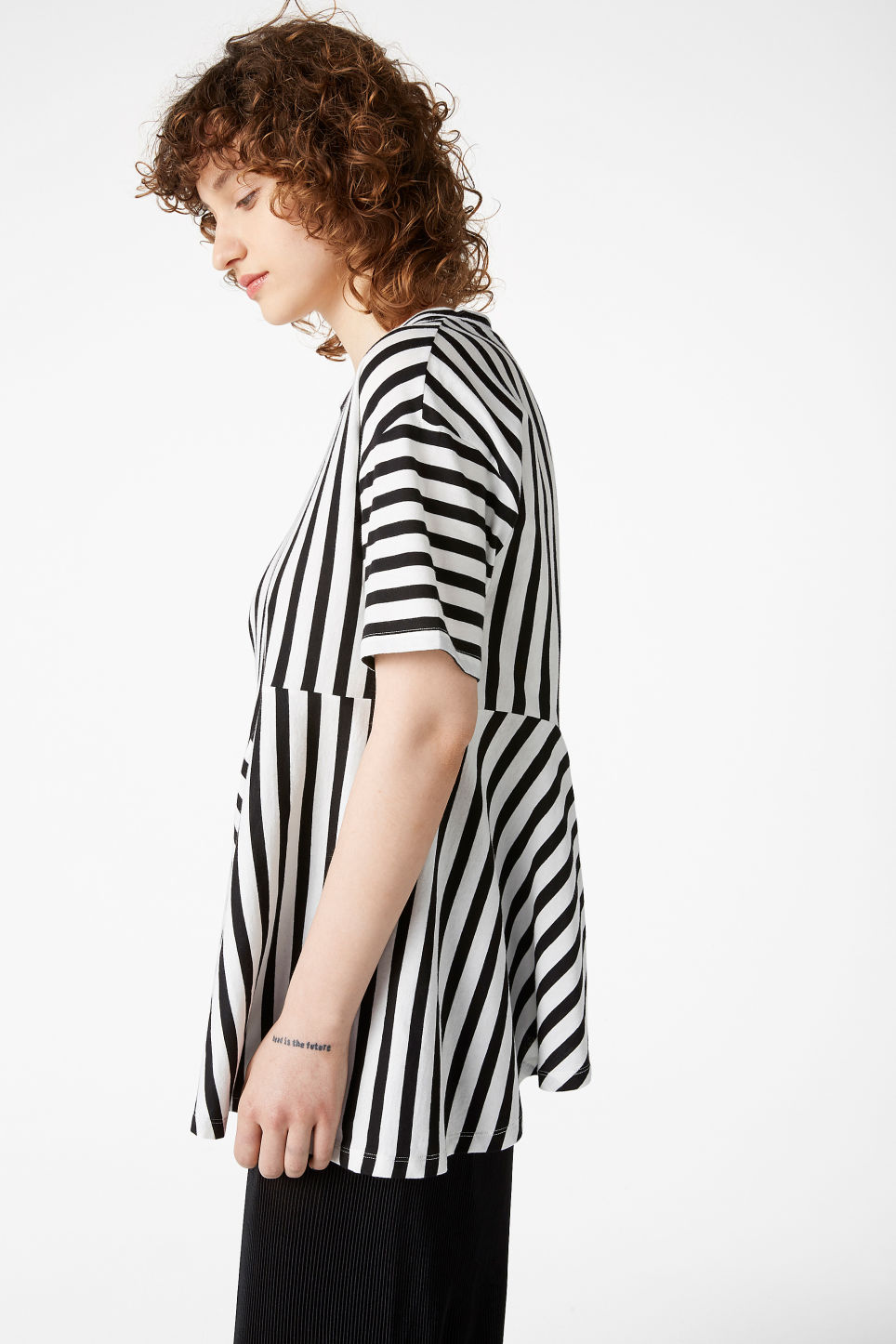 Model front image of Monki asymmetric top in white