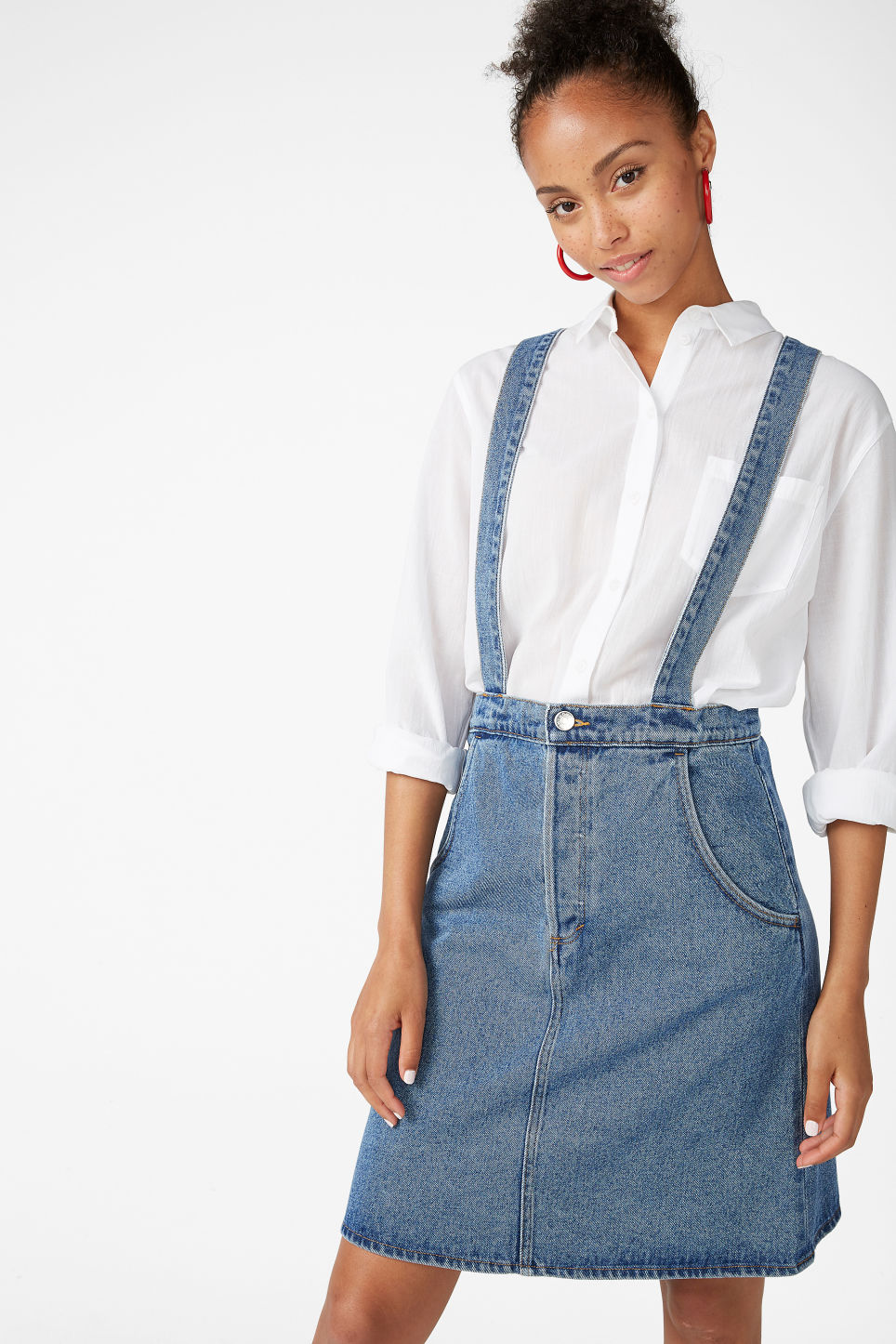 Model front image of Monki denim dungaree skirt in blue