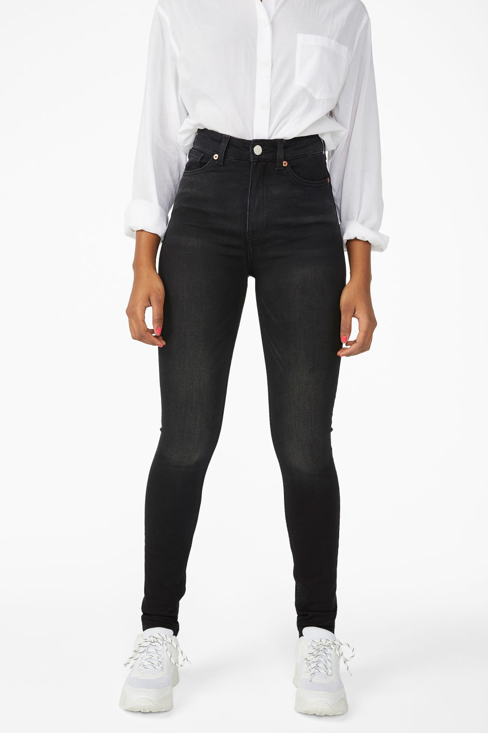 Model side image of Monki oki washed black jeans in black