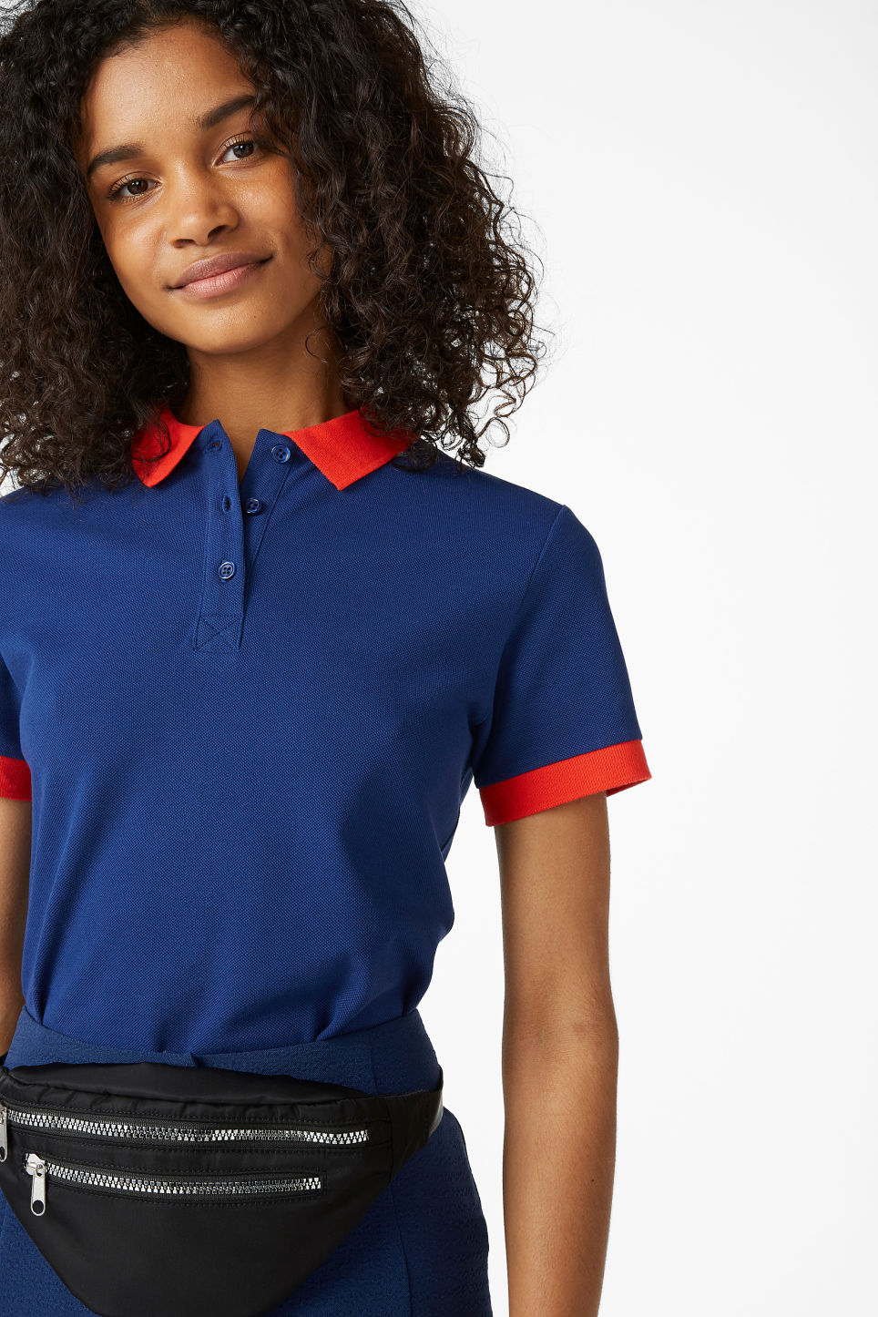 Model front image of Monki piqué polo shirt in blue