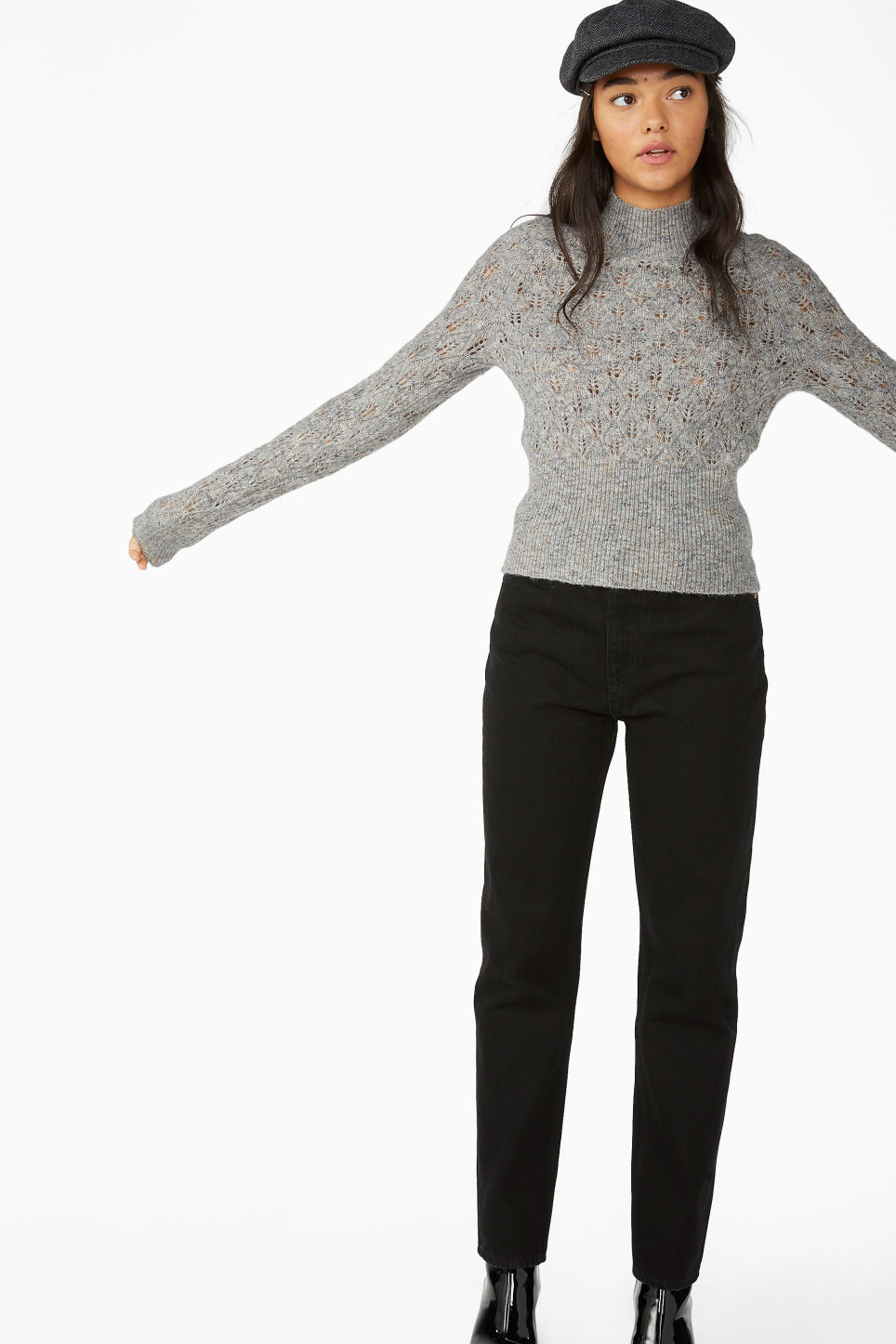 Model side image of Monki knitted turtleneck in grey