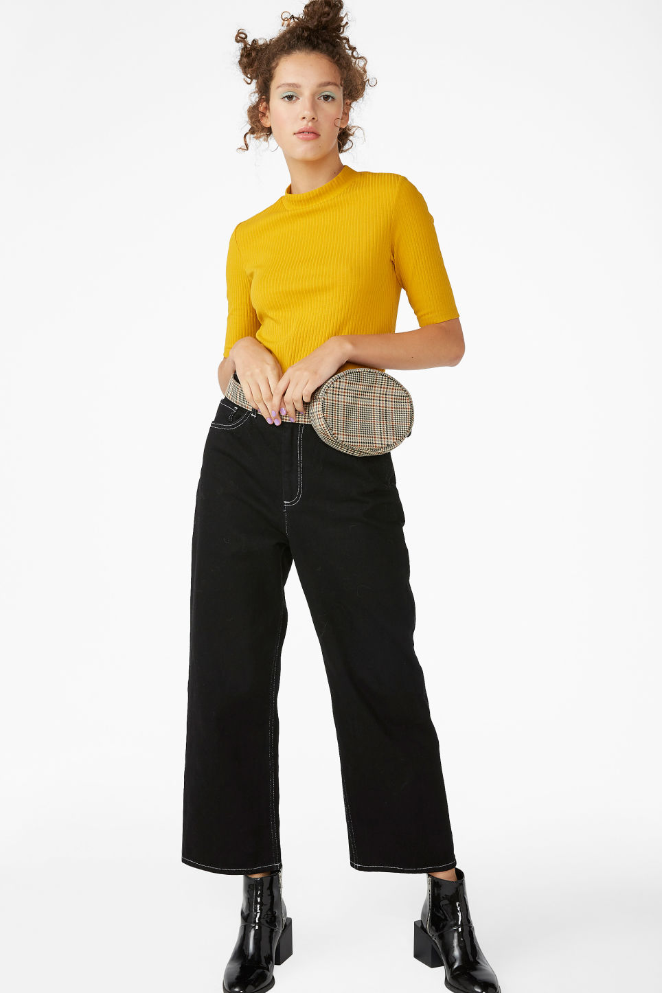 Model side image of Monki ribbed top in yellow