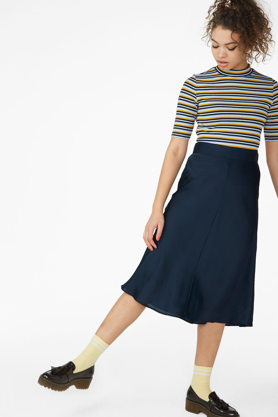 Model side image of Monki low turtleneck top in blue