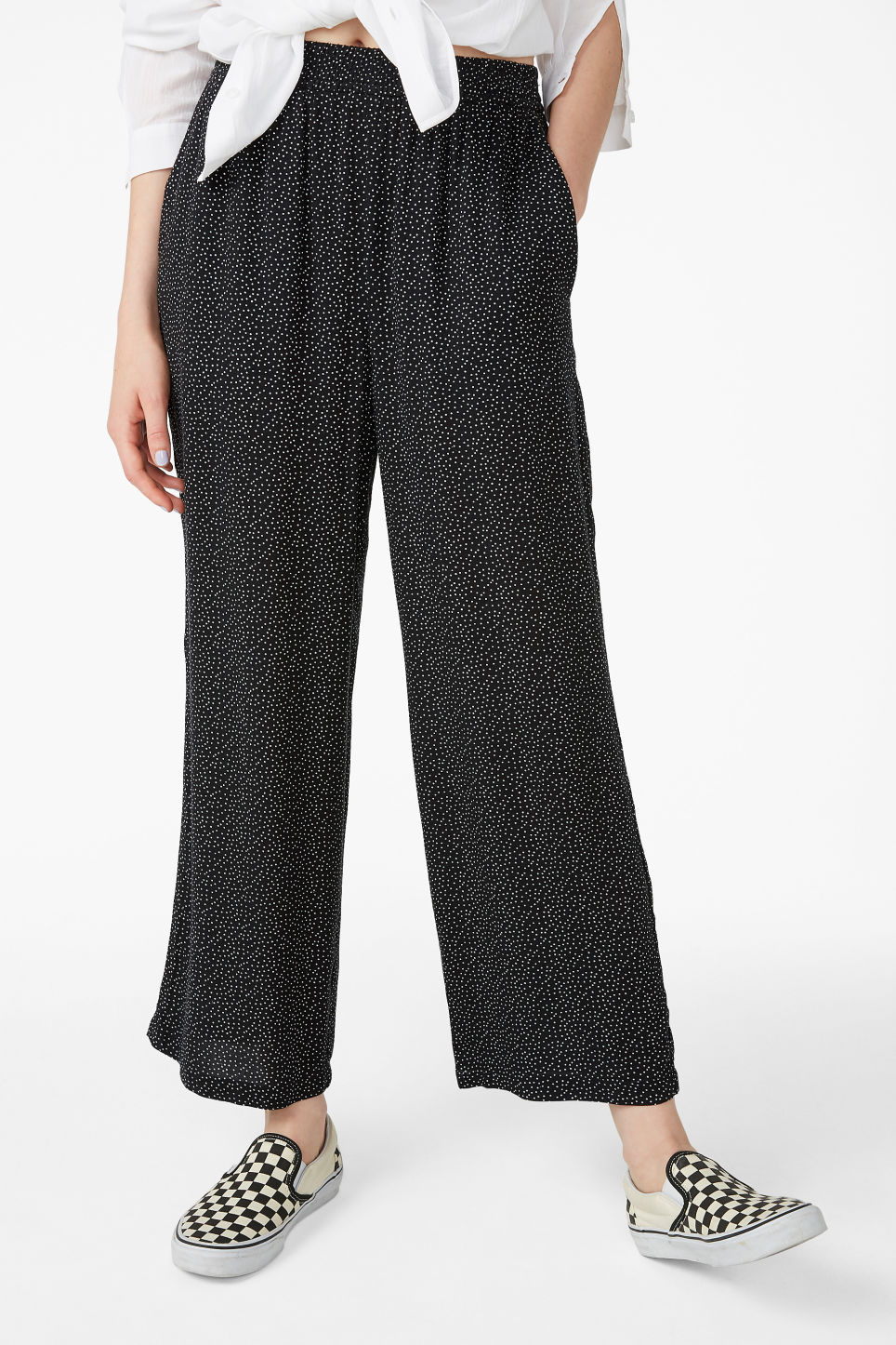 Model side image of Monki relaxed pull-on trousers in black