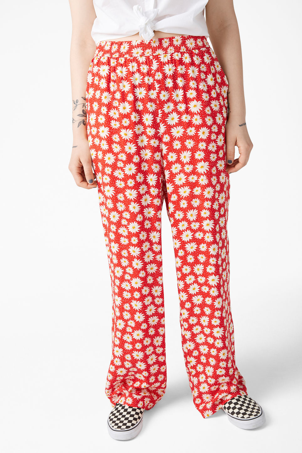 Model side image of Monki relaxed pull-on trousers in red