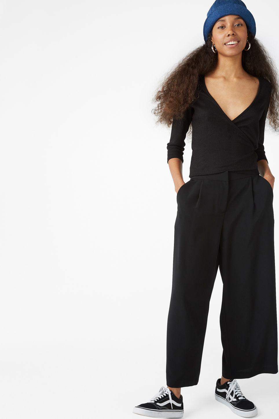 Model side image of Monki ribbed wrap top in black