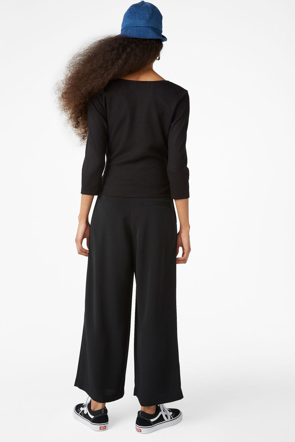 Model back image of Monki ribbed wrap top in black