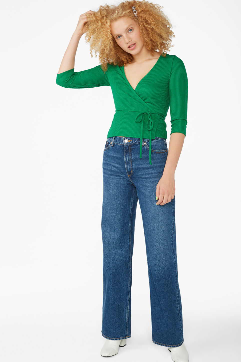 Model side image of Monki wrap top in green