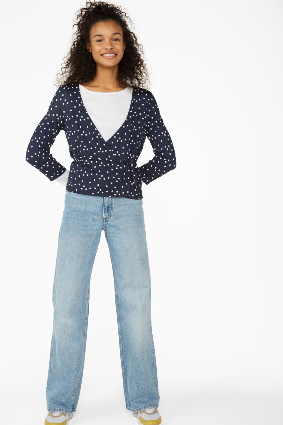 Model side image of Monki wrap top in blue