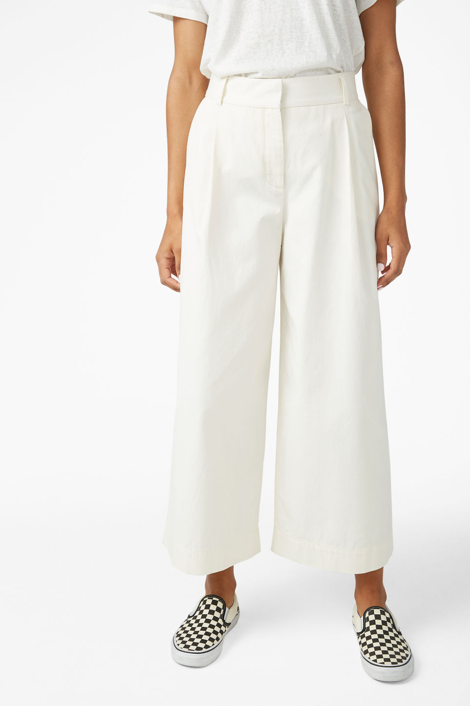 Model side image of Monki wide leg cotton trousers in white