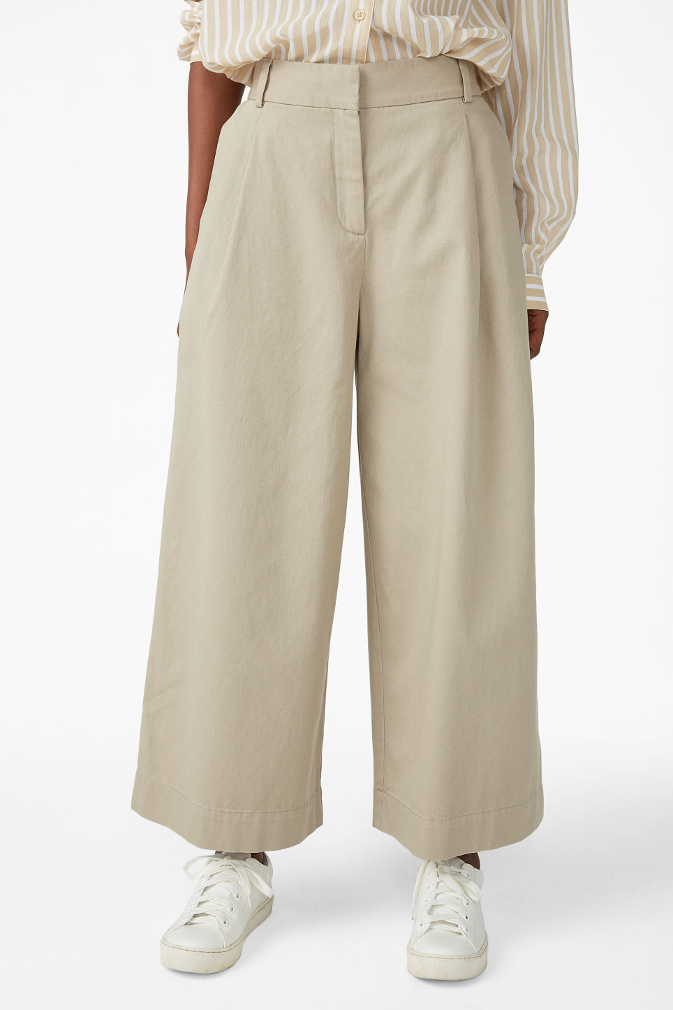 Model side image of Monki wide leg cotton trousers in beige