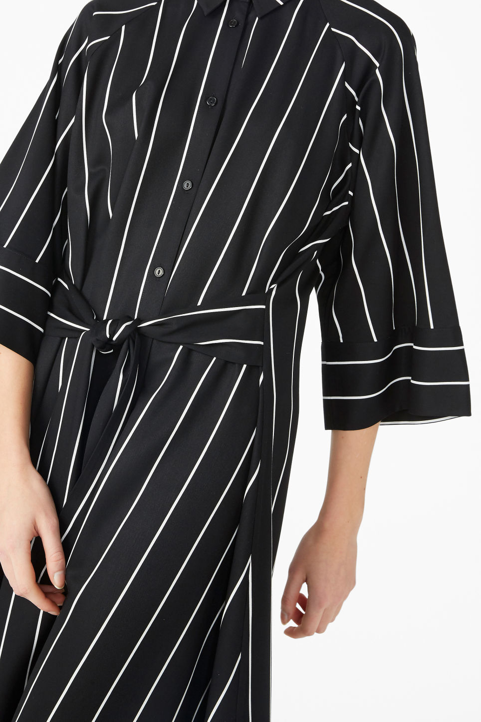 Model side image of Monki belted shirt dress in black