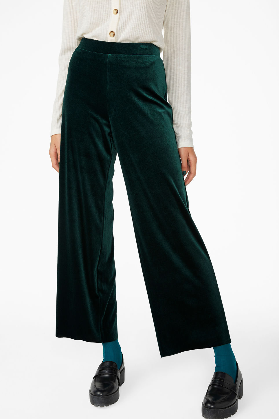 Model side image of Monki wide velvet trousers in green