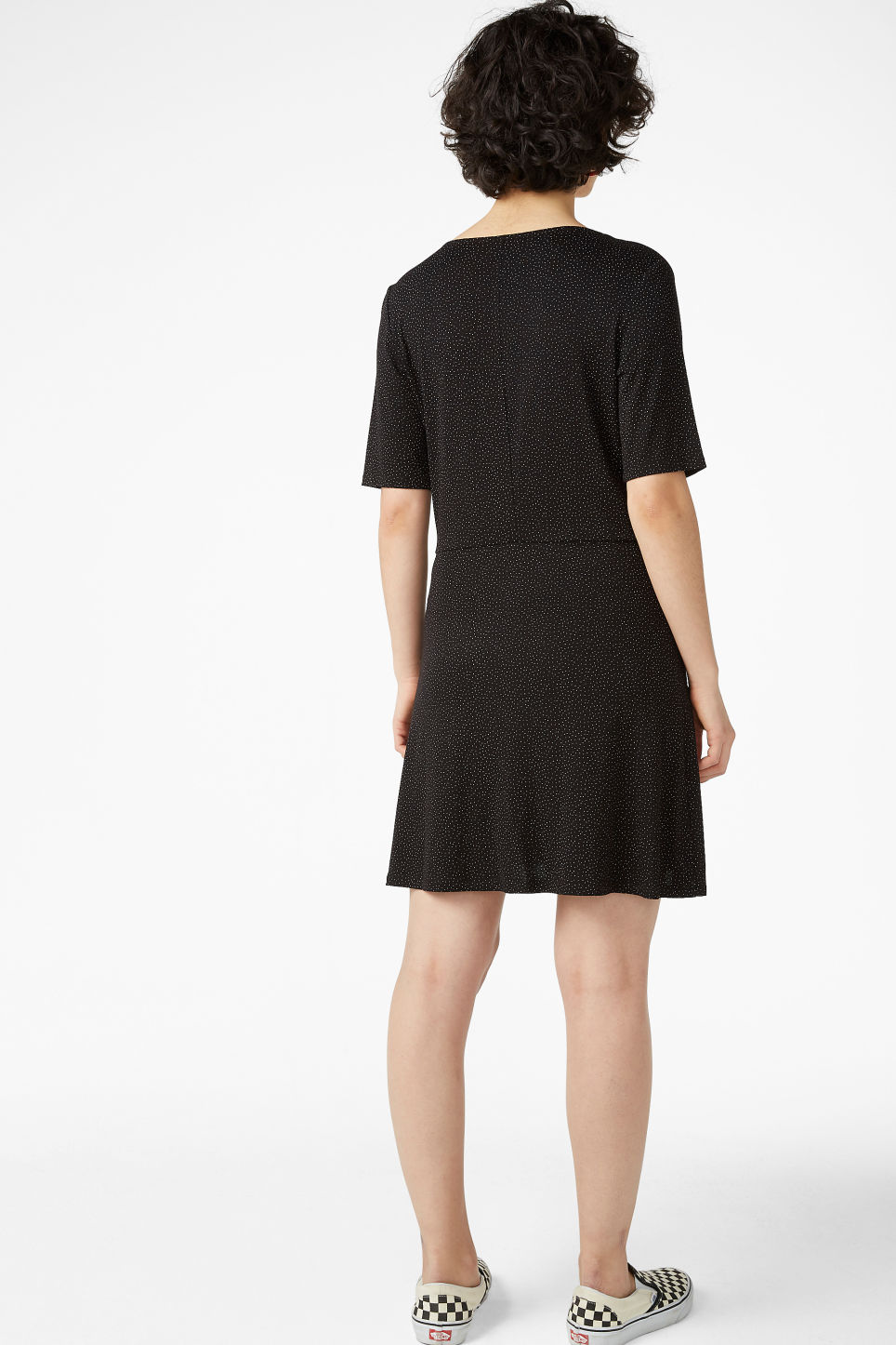 Model back image of Monki wrap dress in black