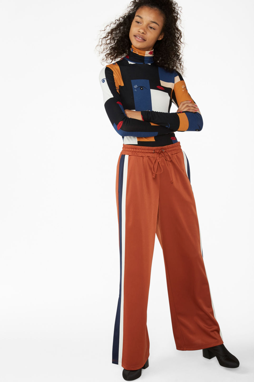 Model side image of Monki stretchy turtleneck top in blue