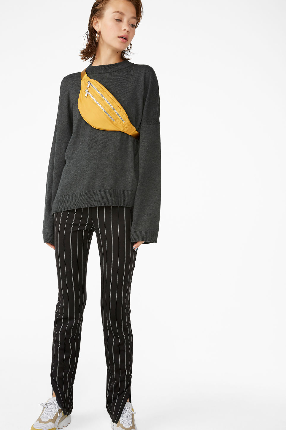 Model front image of Monki pinstriped ankle zip trousers in black