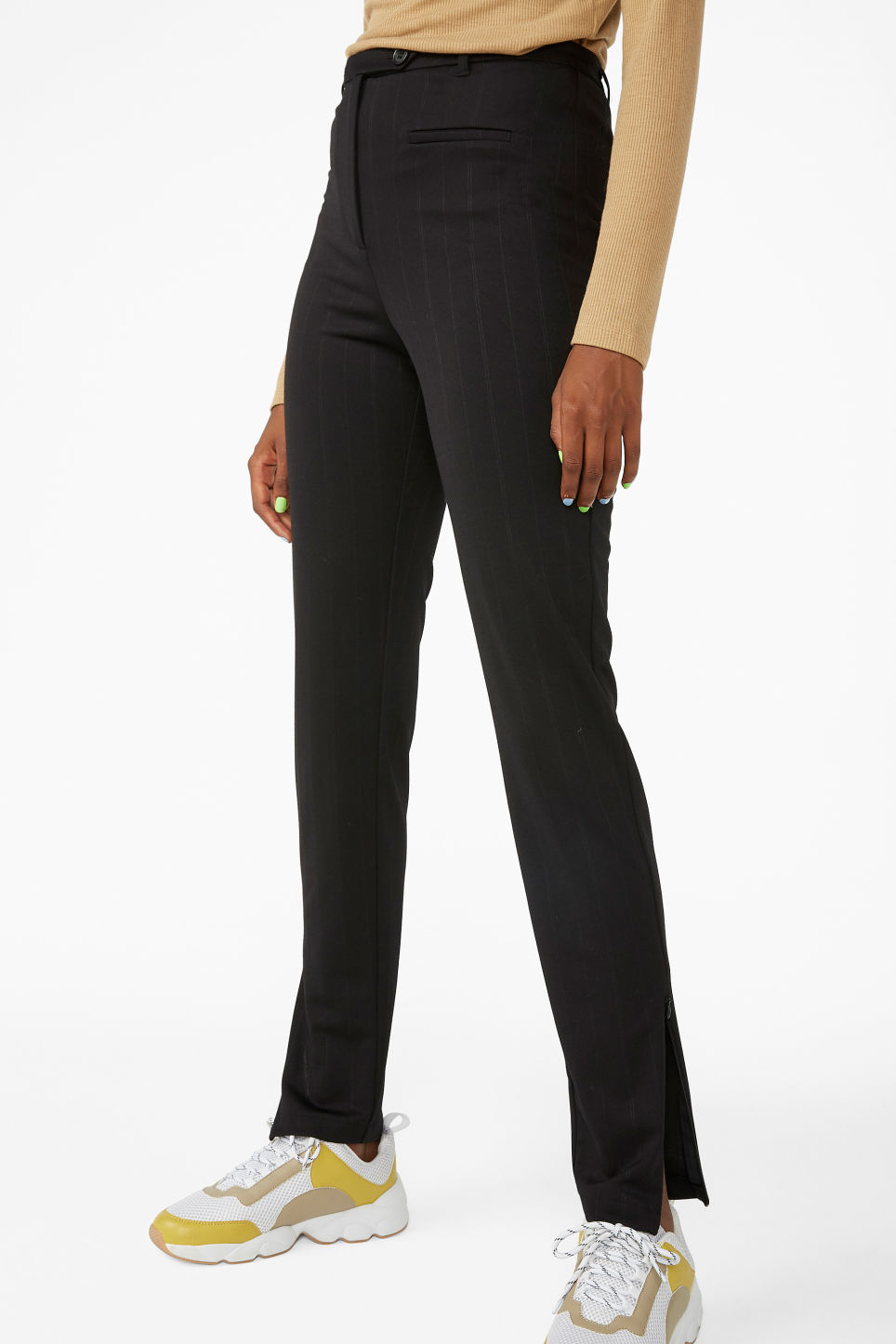 Model side image of Monki pinstriped ankle zip trousers in black