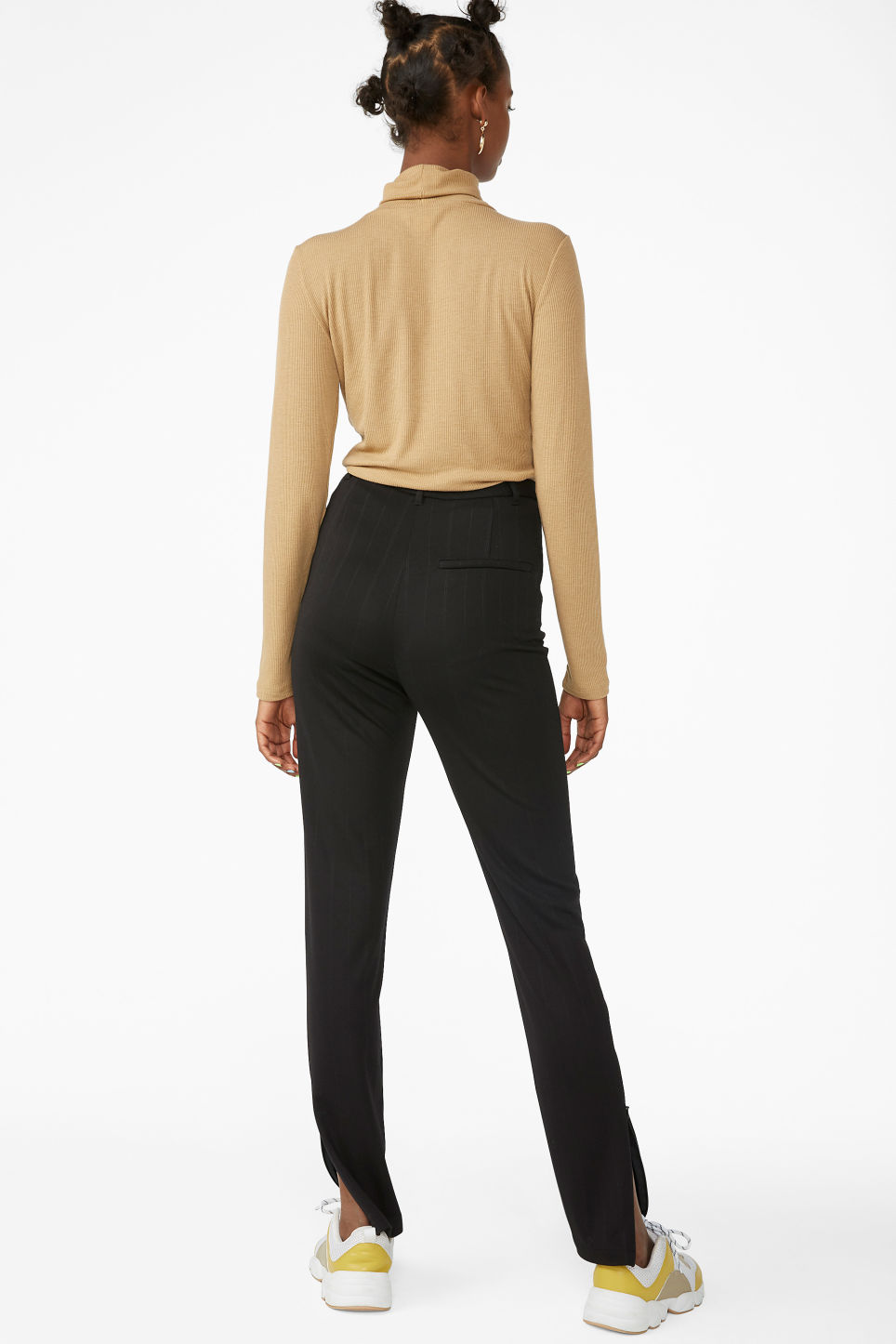 Model back image of Monki pinstriped ankle zip trousers in black