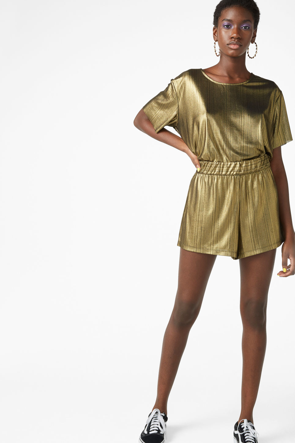 Model front image of Monki flowy shorts in gold