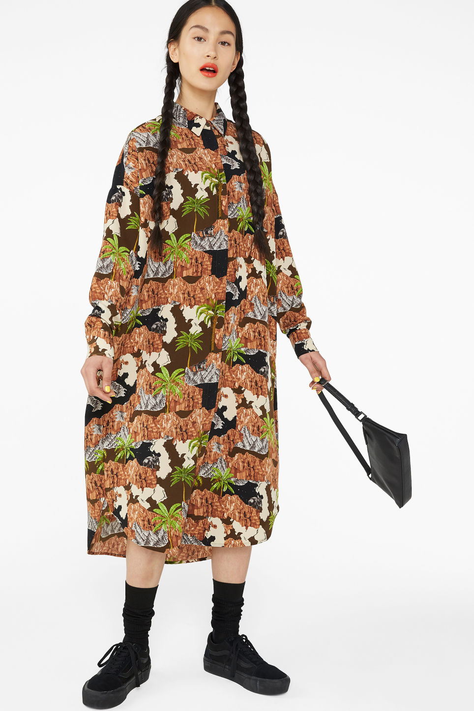Model front image of Monki long hidden button dress in brown