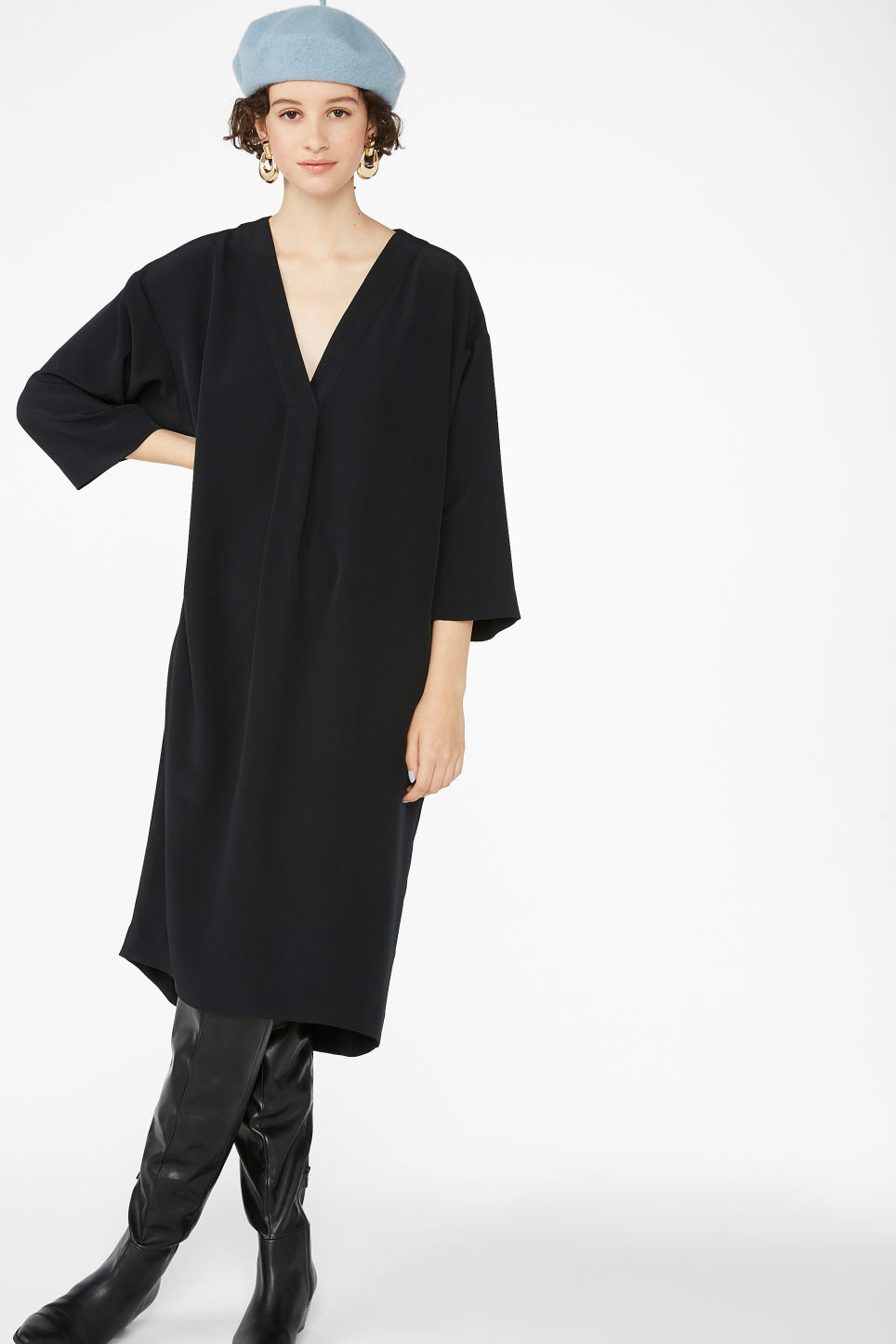 Model front image of Monki oversized v-neck dress in black