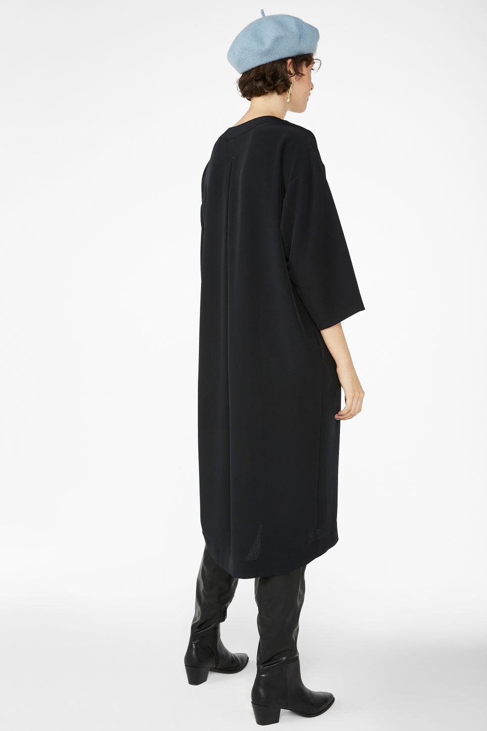 Model back image of Monki oversized v-neck dress in black