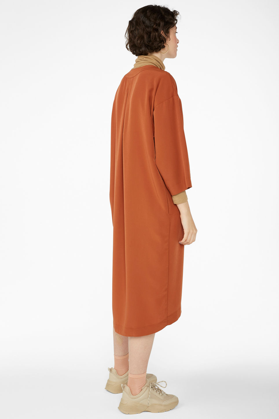 Model back image of Monki oversized v-neck dress in orange