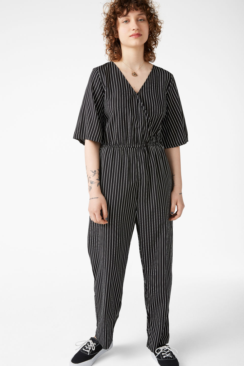 Model front image of Monki pinstripe jumpsuit in black