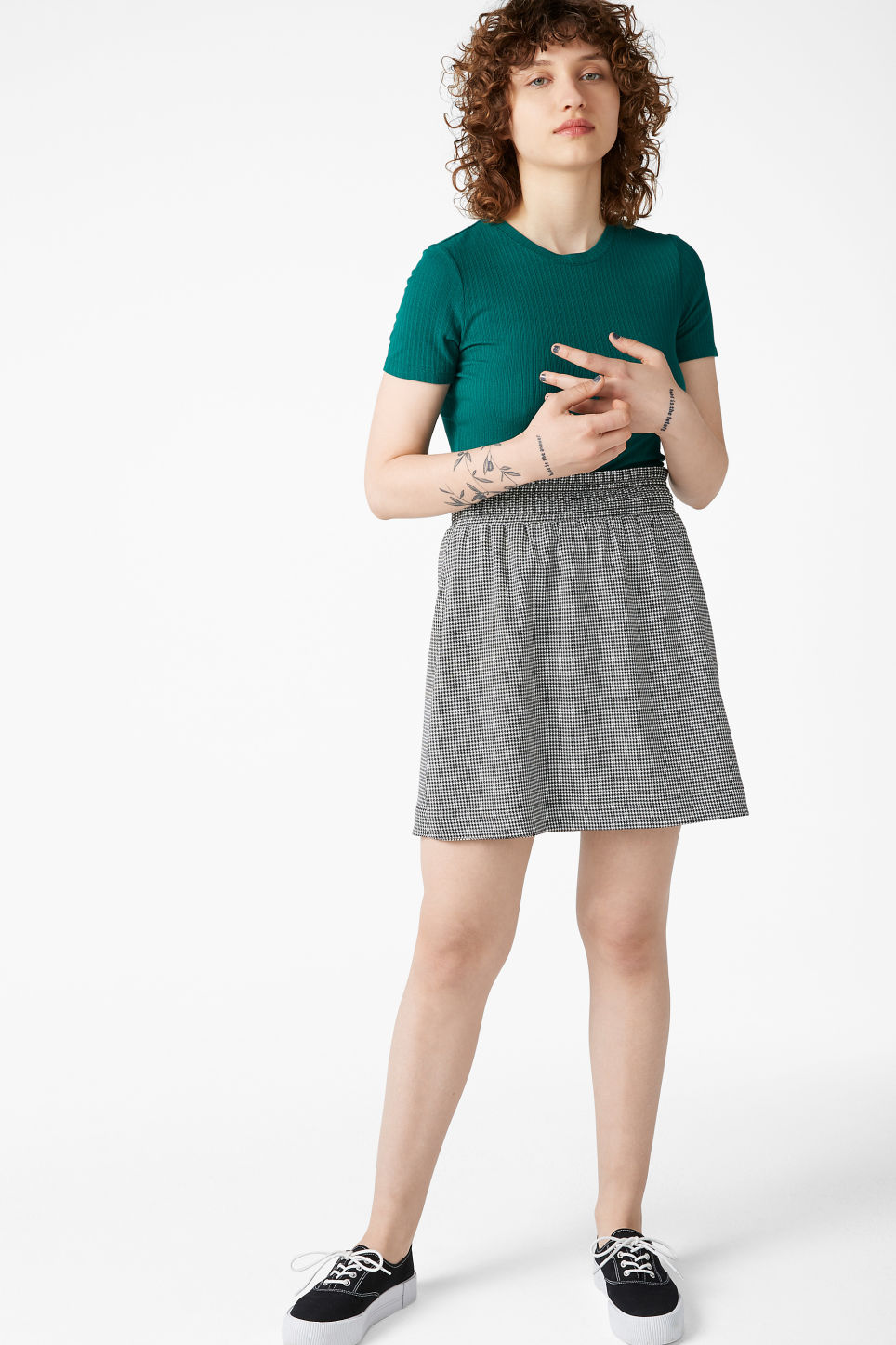 Model front image of Monki houndstooth mini skirt  in white