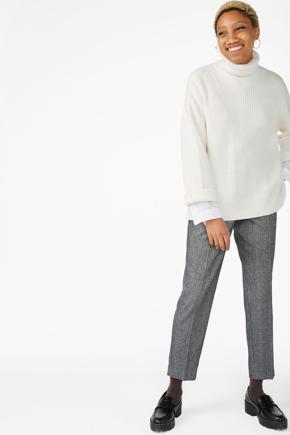 Model side image of Monki knitted turtleneck sweater in white