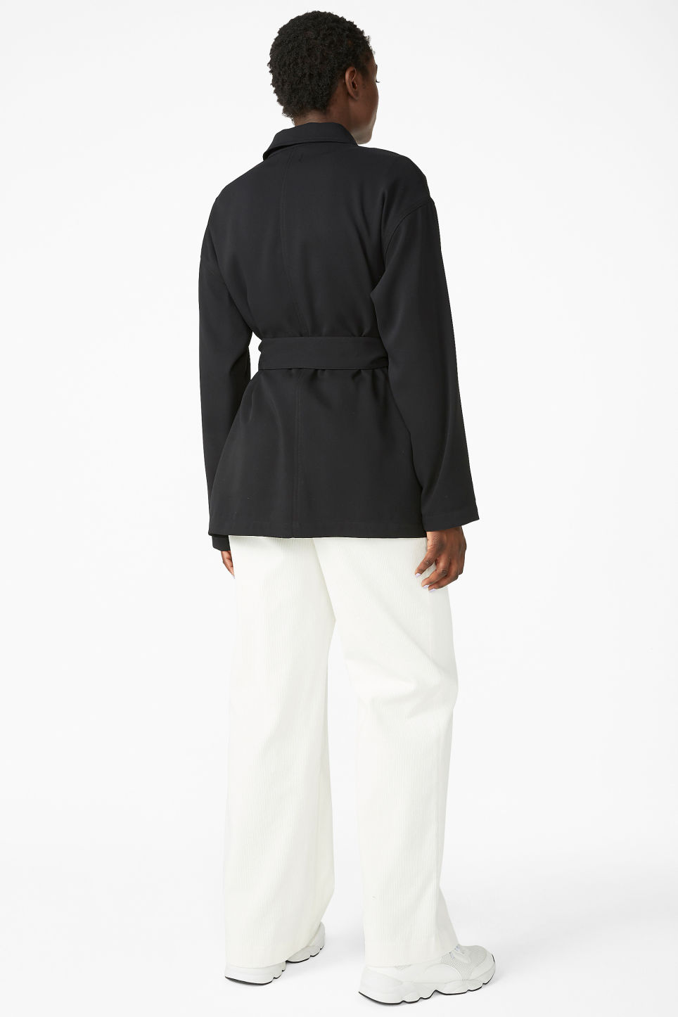 Model back image of Monki belted jacket in black