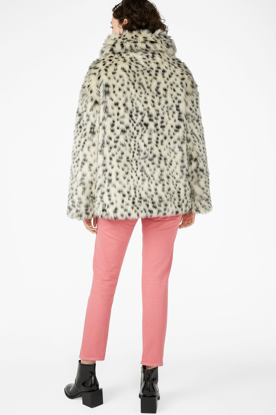 Model back image of Monki faux fur jacket in white