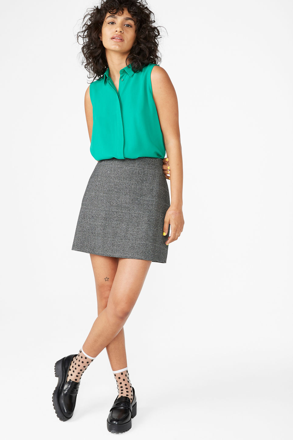 Model side image of Monki flowy sleeveless shirt in green