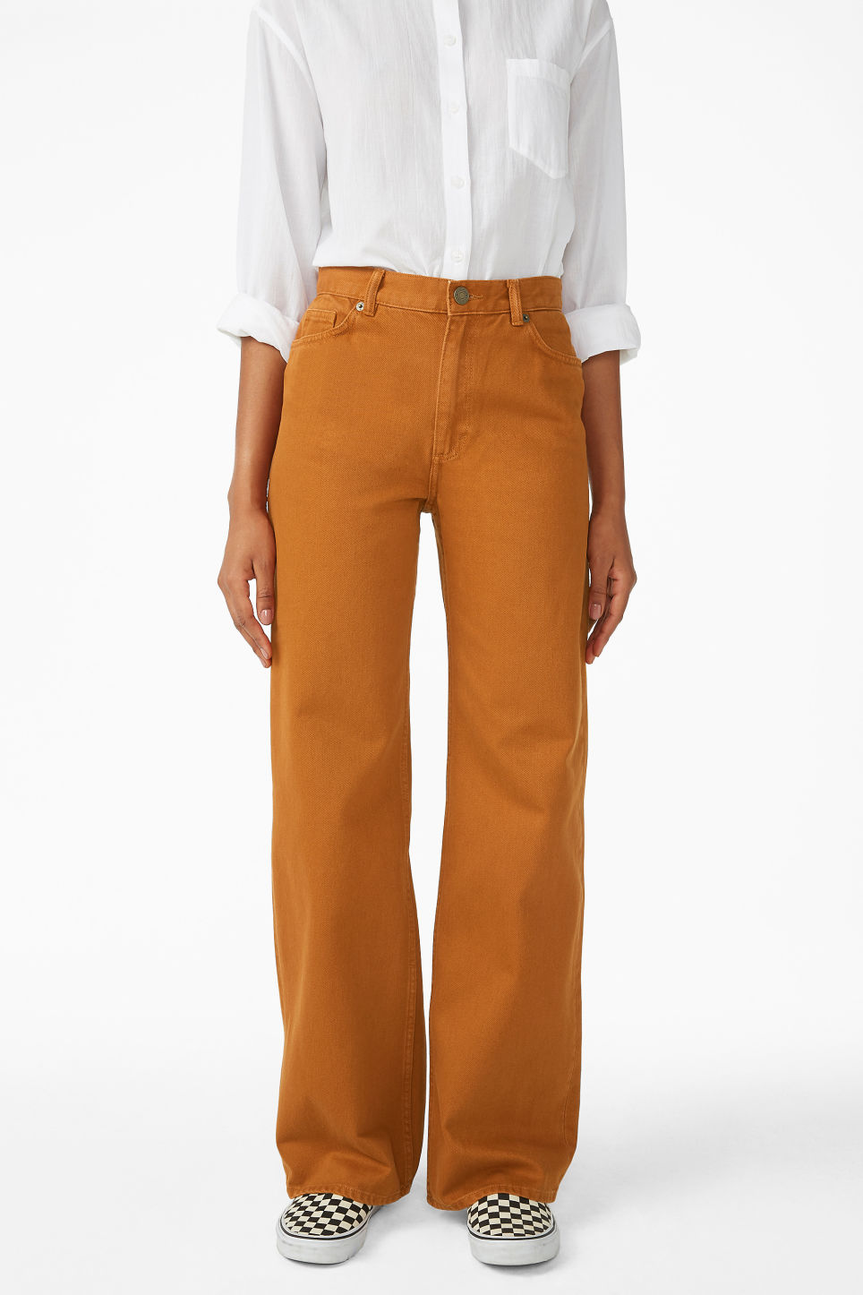 Model side image of Monki yoko dark mustard jeans in orange