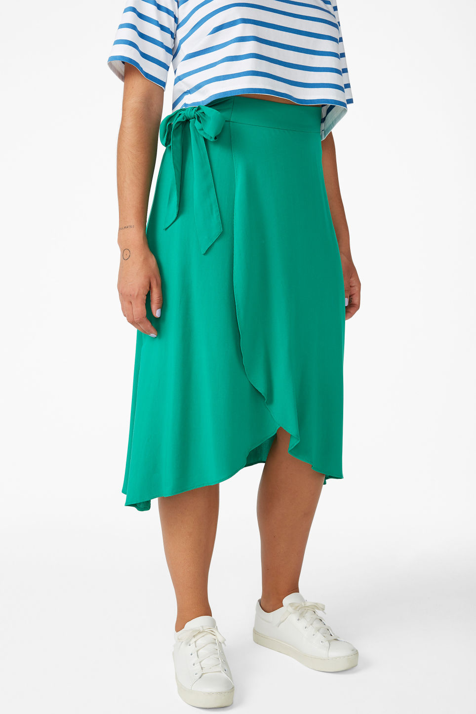 Model side image of Monki wrap front skirt in green