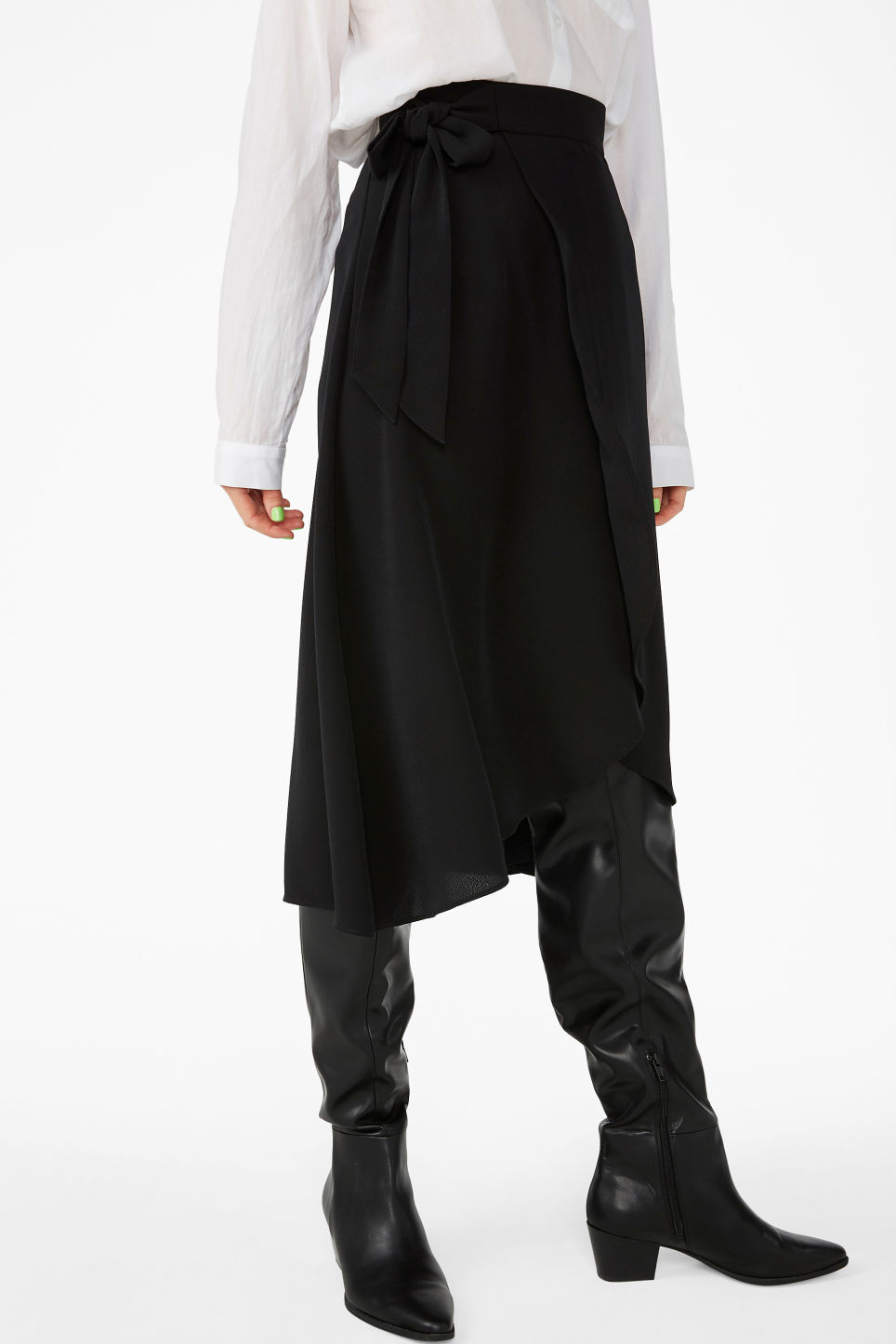 Model side image of Monki wrap front skirt in black