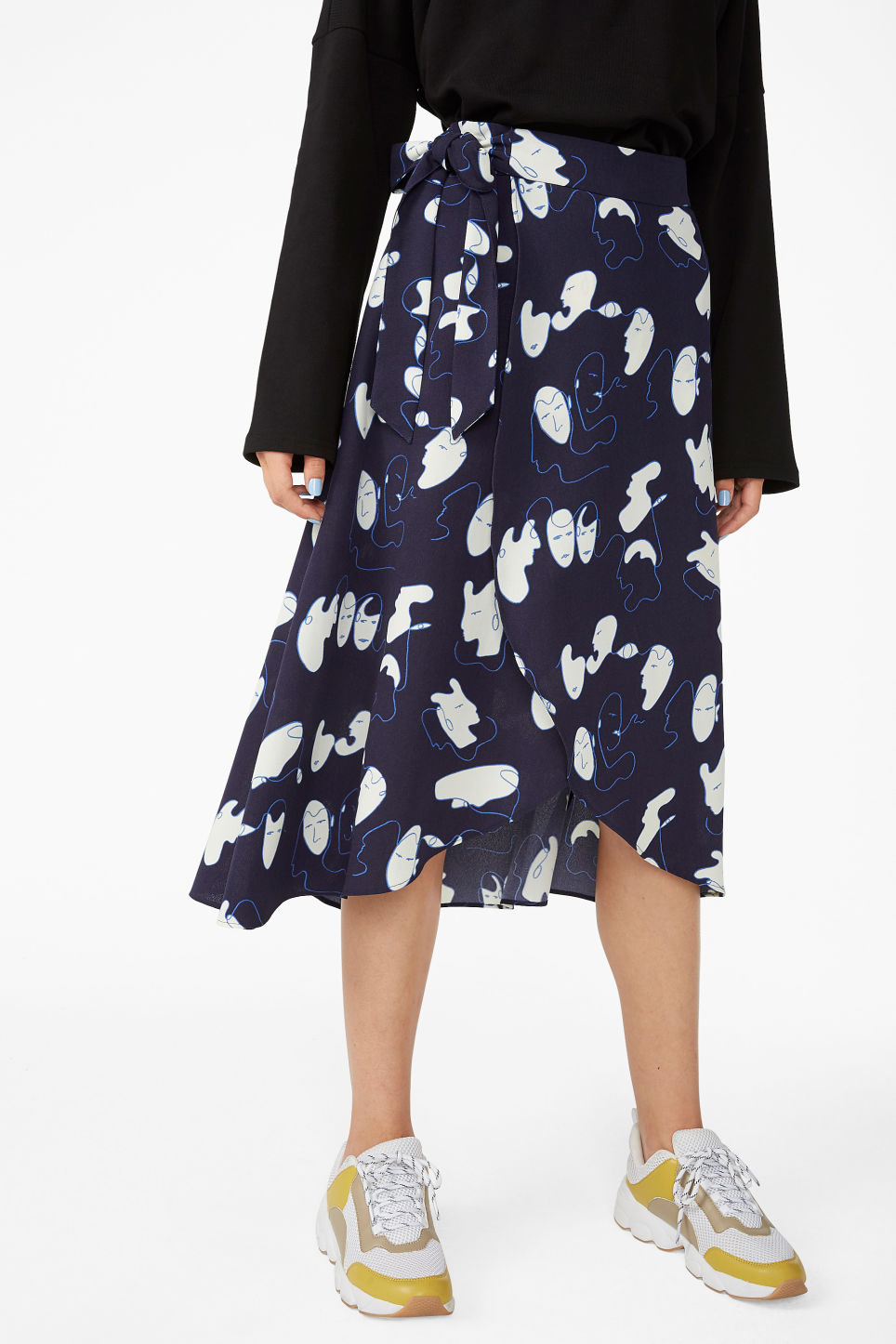 Model side image of Monki wrap front skirt in blue