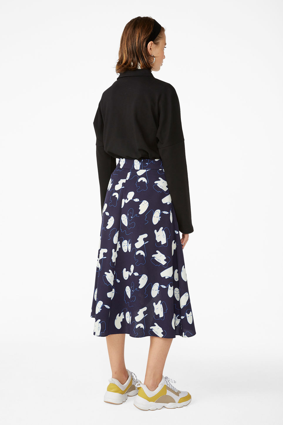 Model back image of Monki wrap front skirt in blue