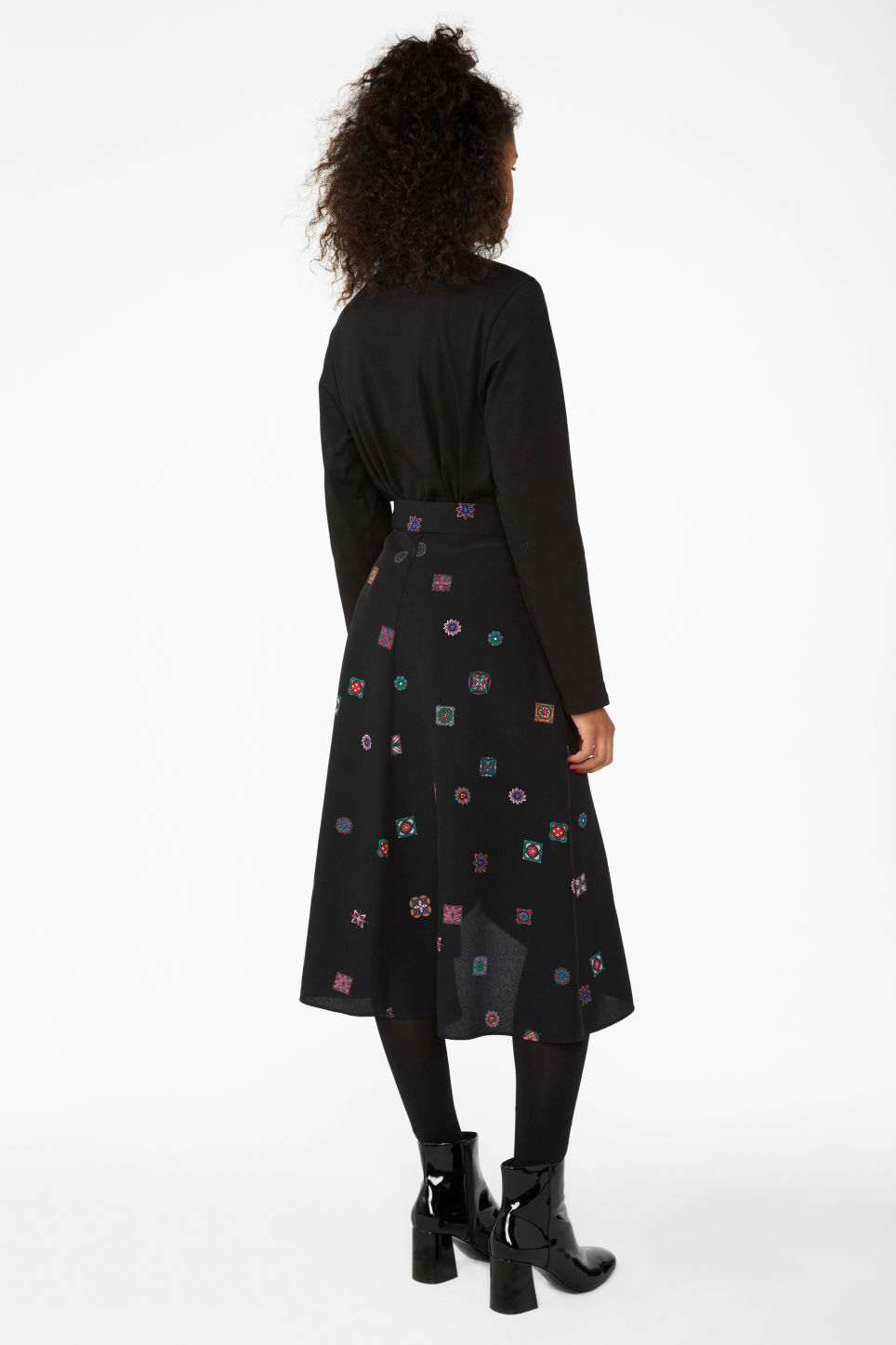 Model back image of Monki wrap front skirt in black