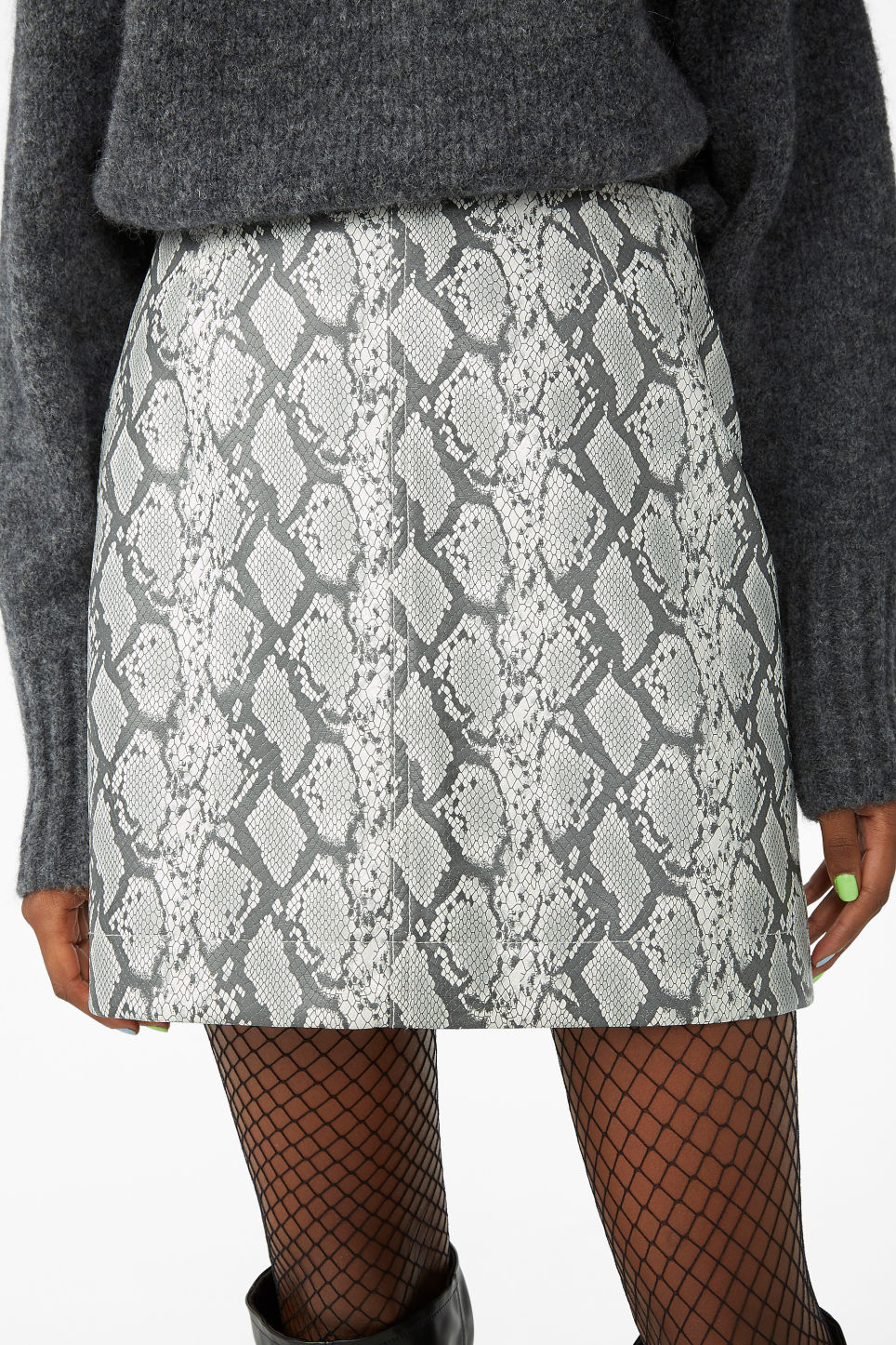Model side image of Monki mini skirt in white