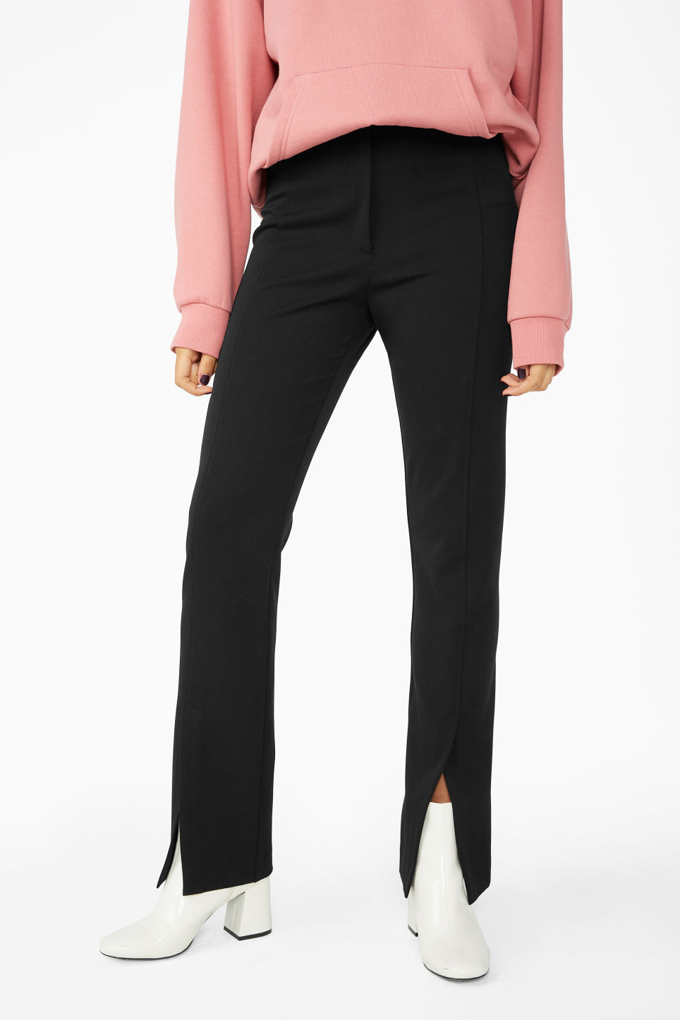 Model side image of Monki front slit trousers in black